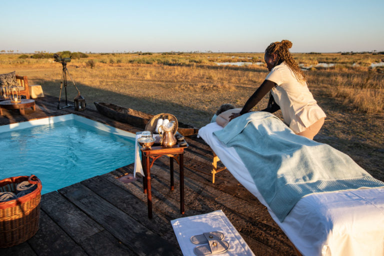 A wilderness spa treatment at the poolside at Selinda Camp