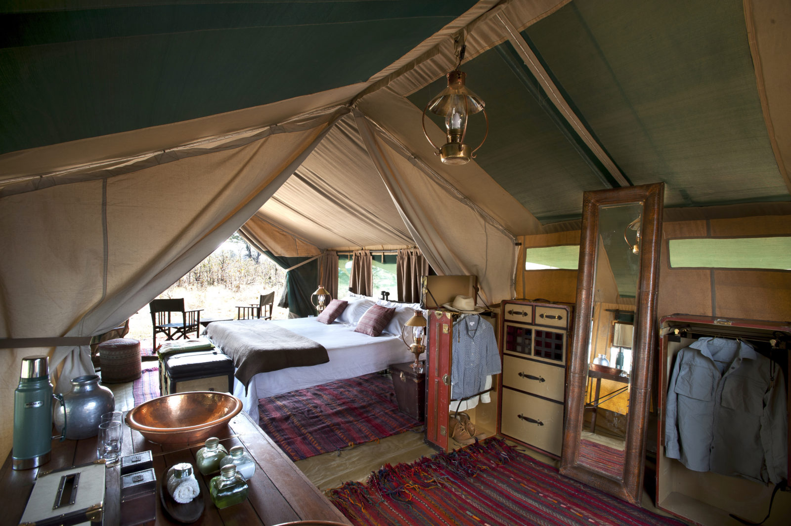 Luxurious guest tent with carpets and copper basin at Selinda Explorers