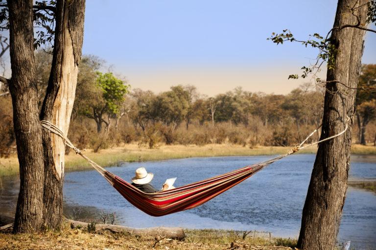 Guest relaxing in hammock at Selinda Explorers Camp