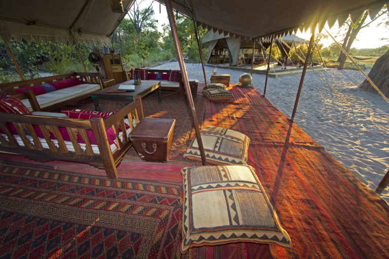Lounge area depicting carpets of Middle Eastern influence at Selinda Explorers