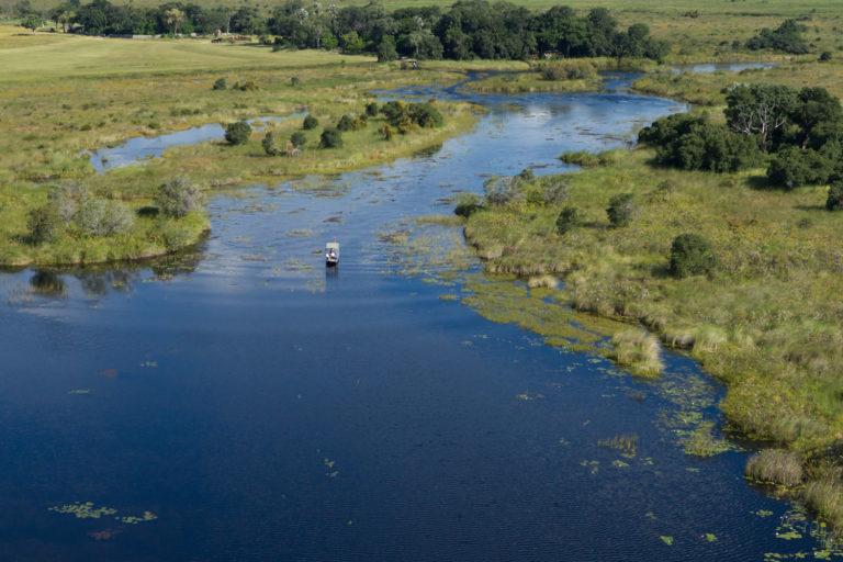 Exploring idyllic waters by Mokoro from Shinde Camp
