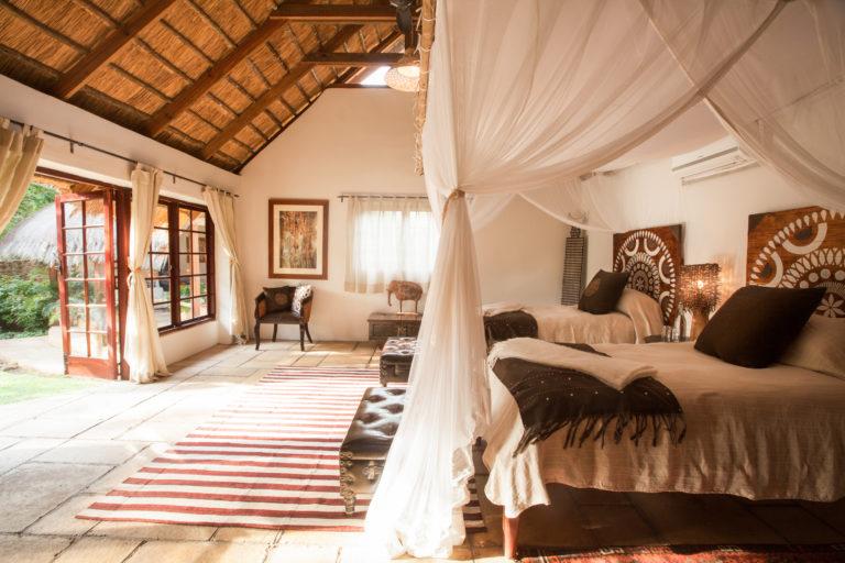 Elegant decor of The garden cottage bedroom at Tongabezi