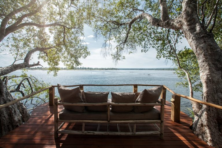 Relax on your private deck at the Tongabezi river cottages