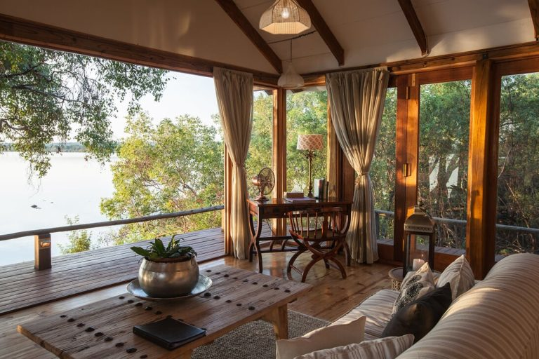 The deck from the Dog House at Tongabezi overlooks the river