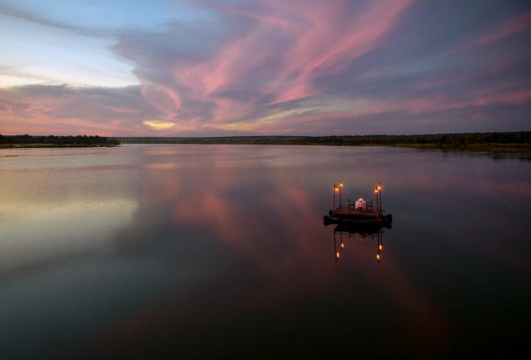 The iconic private dining Sanpan floating on the Zambezi at Tongabezi
