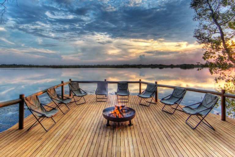 Xugana's fire pit and guest seating arranged to overlook the lagoon
