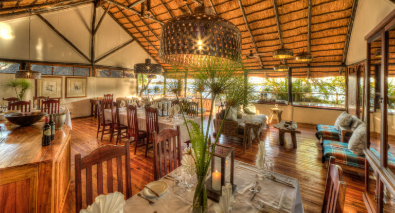 Xugana Lodge has an indoor dining area and fully stocked bar
