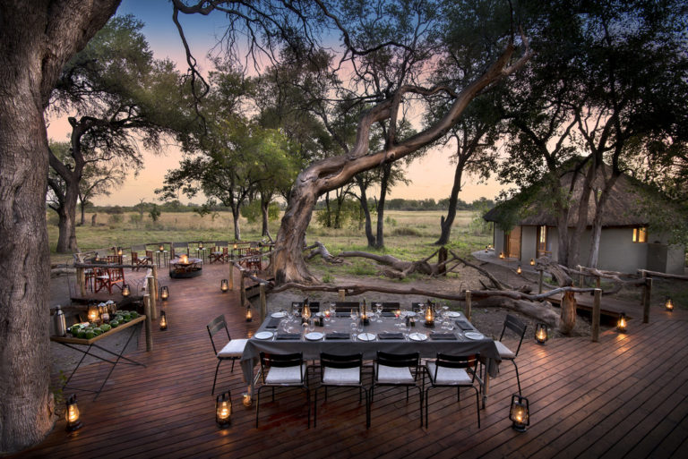 Early evening dinner in picturesque outdoor setting with Khwai Tented Camp