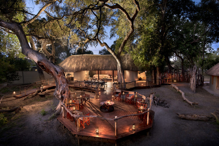 Fire pit scene at dusk at Khwai Tented Camp