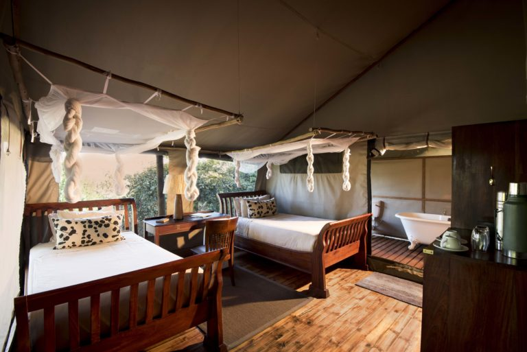 Twin beds in guest tent at Linyanti Ebony Camp