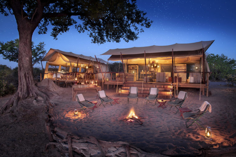 Linyanti Expeditions camp fire main area at night time