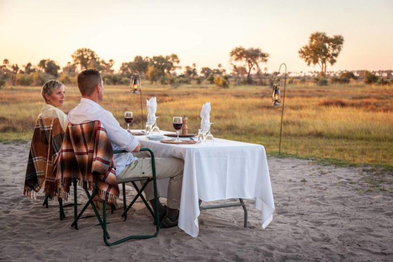 Private romantic bush dinner table at Gomoti Plains