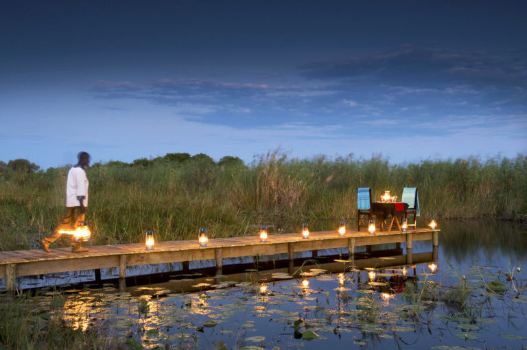 Exclusive private dinner on the water boardwalk at Selinda Camp
