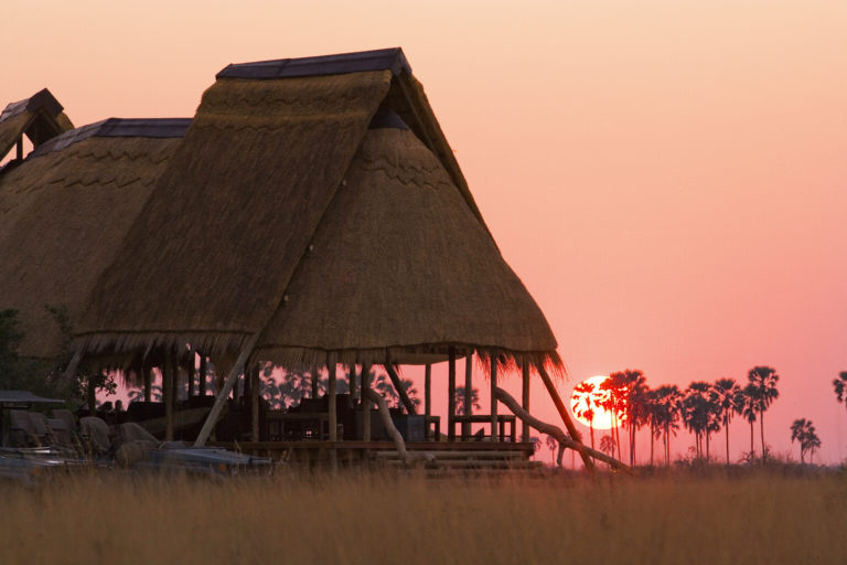 The thatched Selinda Camp at dusk