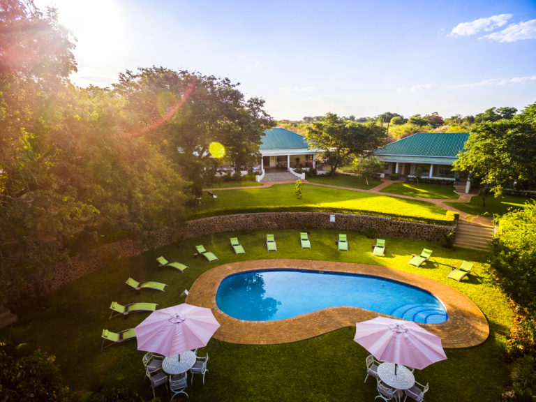 Aerial view of beautiful gardens and swimming pool at Batonka