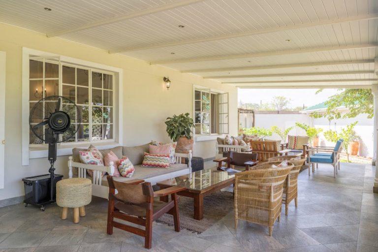 Batonka's outside lounge and veranda open onto the well manicured gardens