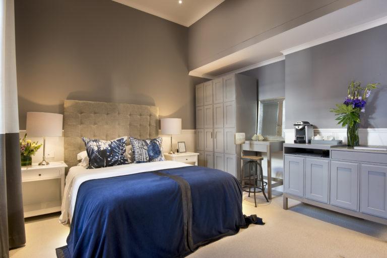 The bedroom interior of a single classic room at Cape Cadogan