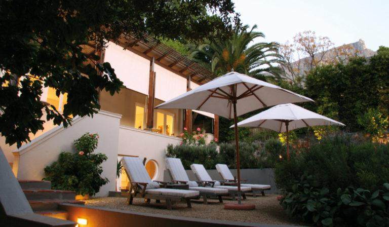 Four Rosmead sun loungers against hotel exterior backdrop