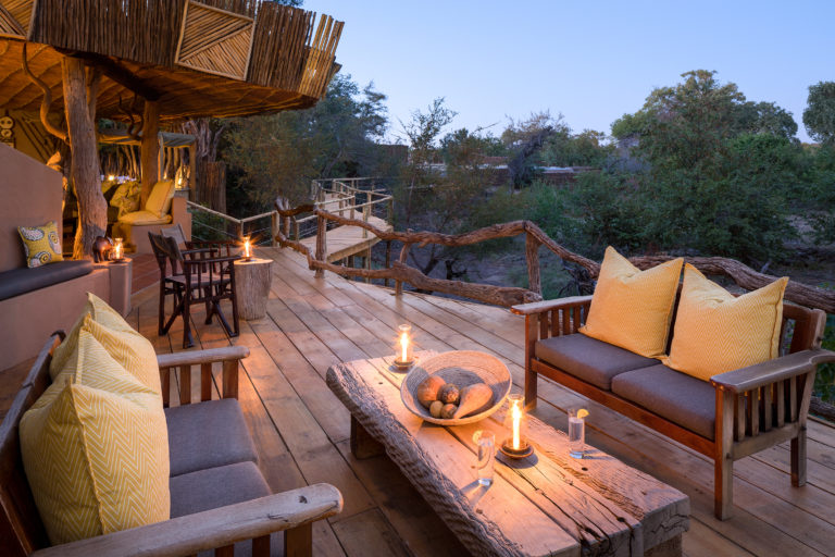 The outside lounge and wooden deck at Mashatu lodge