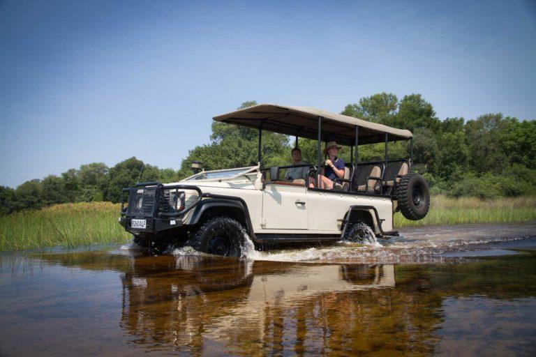 Water crossing on safari with Mopiri Camp vehicle