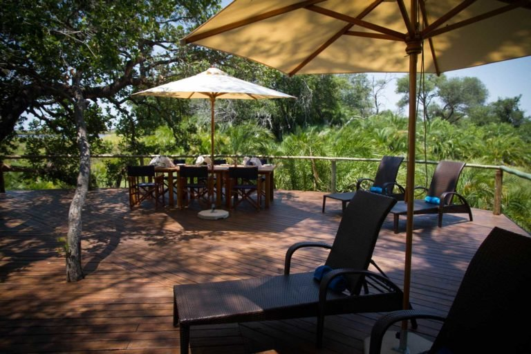 Mopiri's swimming pool deck with sun loungers offers respite from the heat