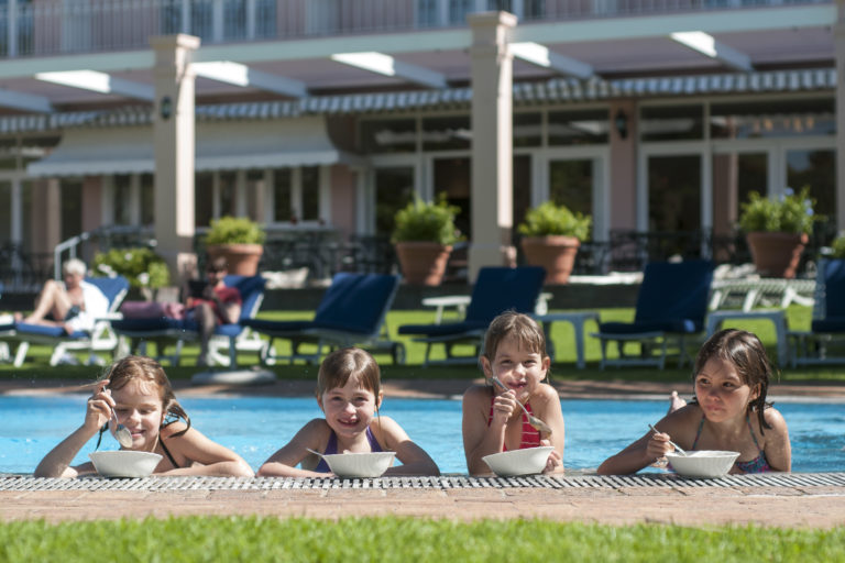 Kids make the most of the sparkling pool at Mount Nelson Hotel