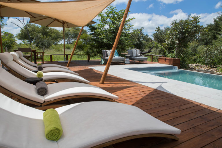 Sun loungers invite guests to unwind at the pool area at Nokonyana