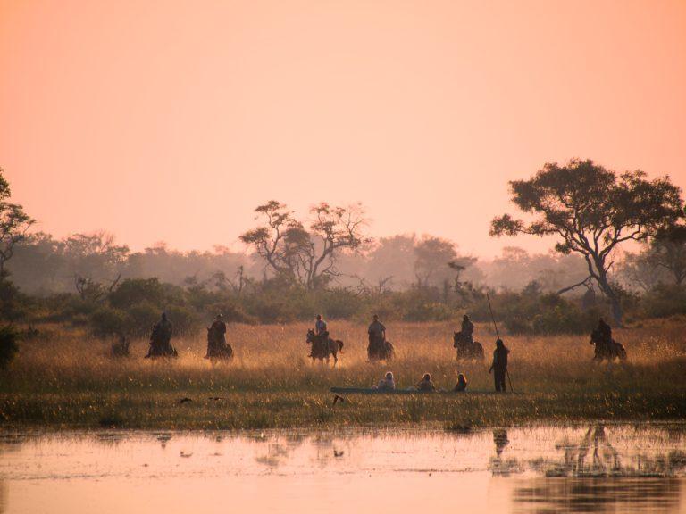 Sunset riders and mokoro with Okavango Horse Safaris