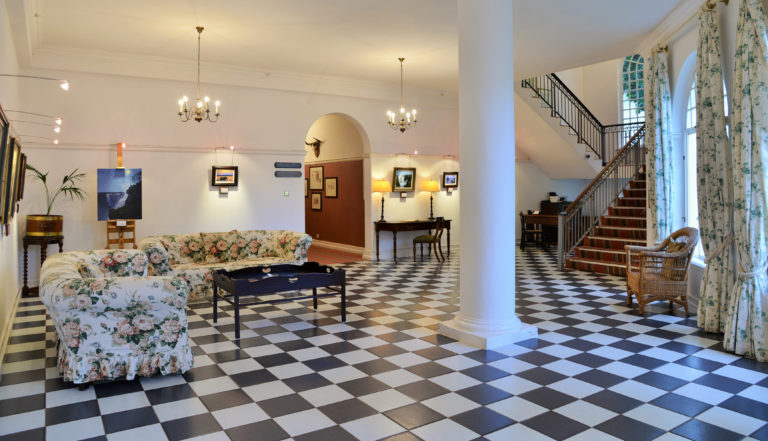The Palm lounge adds to the historical ambiance of Victoria Falls Hotel