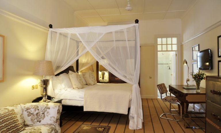 The elegant Stables Signature room at Victoria Falls Hotel
