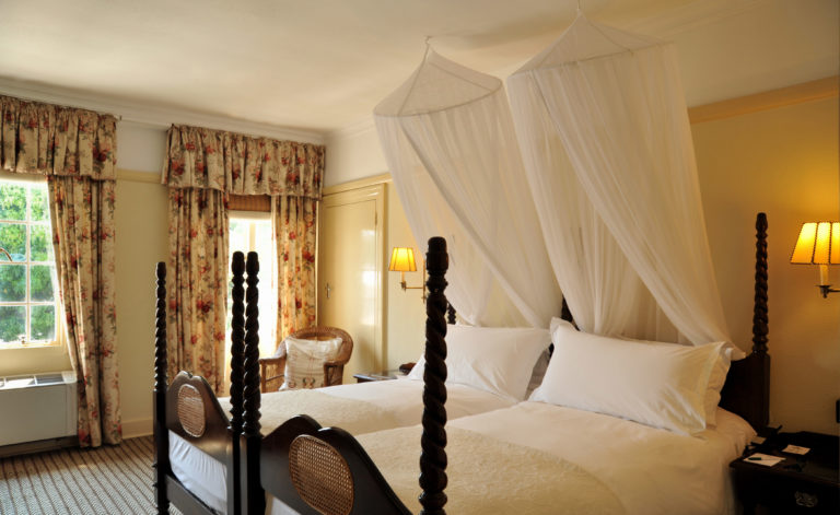 View of the elegantly furnished standard rooms at Victoria Falls Hotel