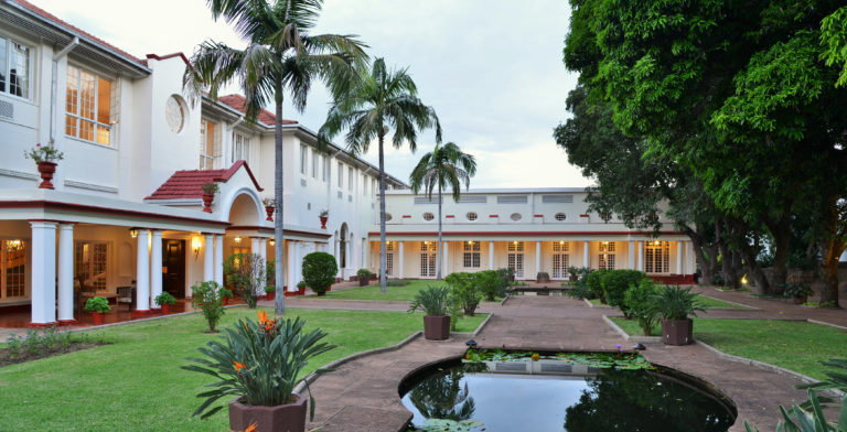 Courtyard and front facade of the iconic Victoria Falls Hotel