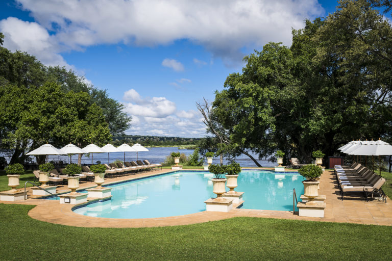 The refreshing swimming pool set in magnificent gardens at The Royal Livingstone