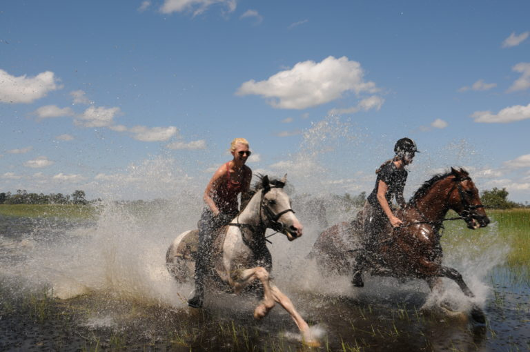 Africa Horse Back Safaris riders under clear Botswana sky
