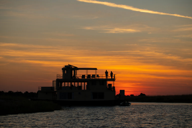 Early evening silhouette of the Chobe Princess on the river