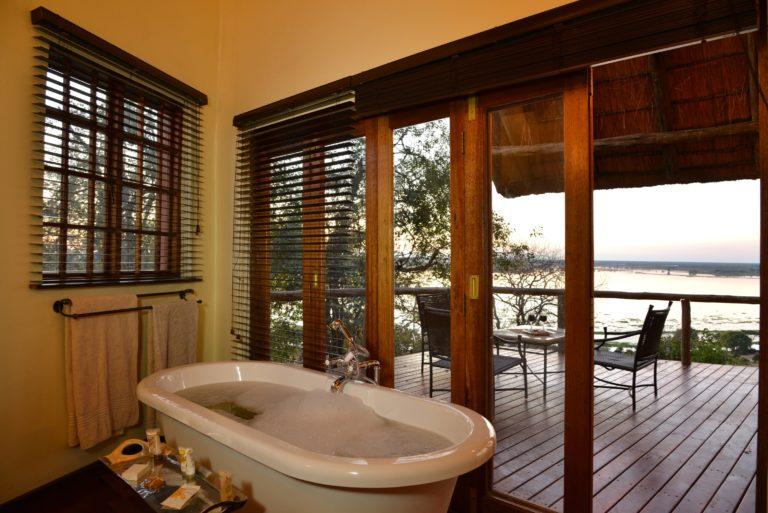 Freestanding luxury bath tub with view at Muchenje Safari Lodge