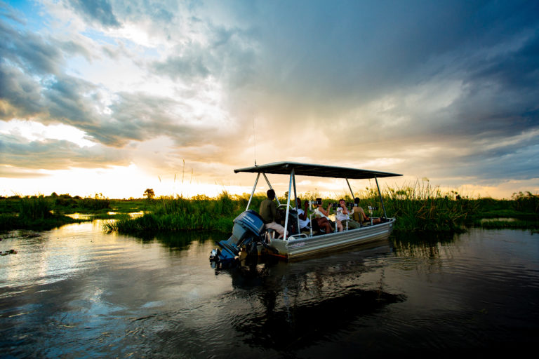 Duba Plains Suite camp offers exciting boating activities when water levels permit