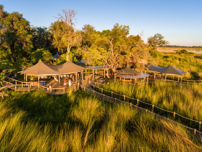 The scenic Little Vumbura Camp is located on an island and surrounded by water