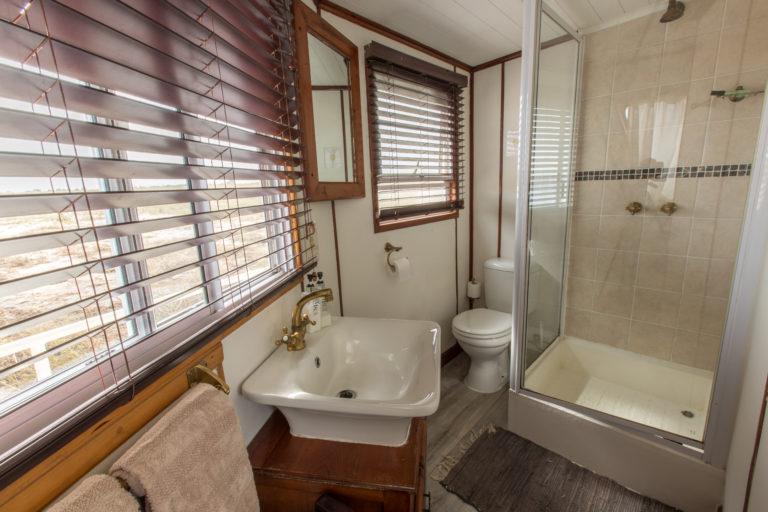 Pangolin Voyager houseboat guest bathroom