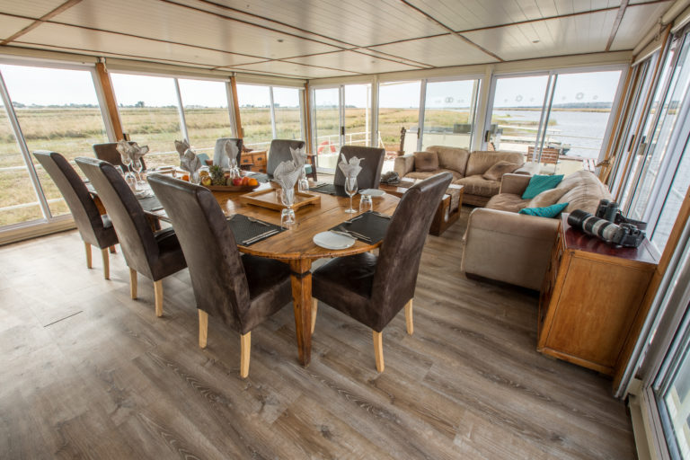Pangolin Voyager houseboat lounge and dining area