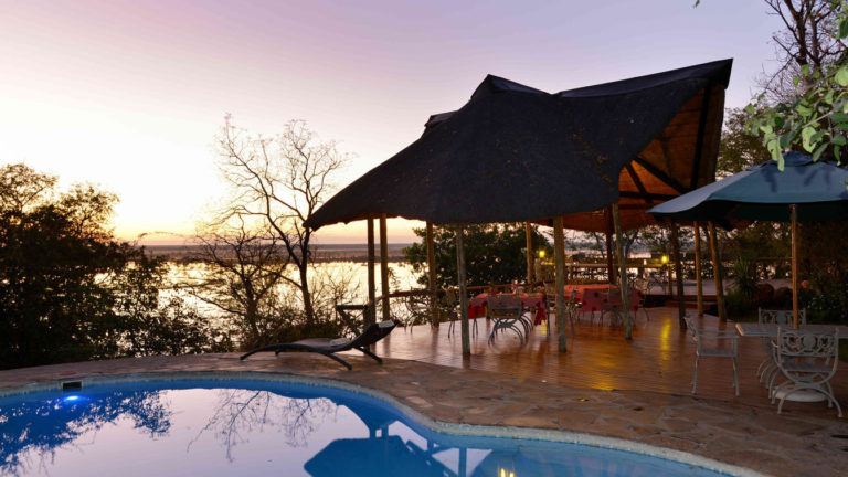Muchenje pool deck with thatched eating area and loungers