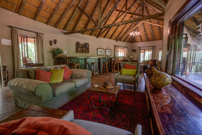 The simple colourful lounge area at Royal Tree Lodge