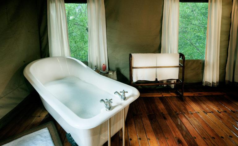 Royal Tree Lodge bathroom with freestanding bath