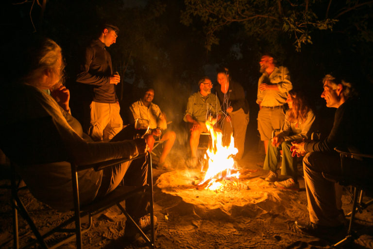 Guests sharing experiences around the camp fire at Bushman Plains Camp