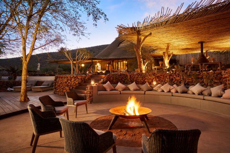 The Motse fire pit against luxury lodge backdrop