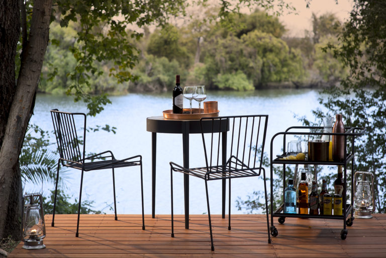 Private dinner for two with scenic river view at Thorntree River Lodge