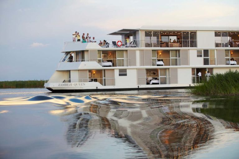Zambezi Queen with its 14 air conditioned cabins cruising at dusk