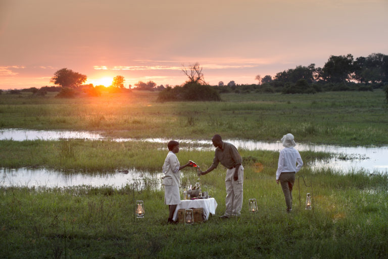 Guests enjoy their sundowners in a gorgeous wilderness setting