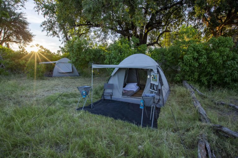 Simple guest tent set up on camp site with Beagle Expedition