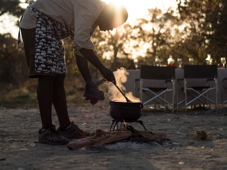 Traditional food preparation at camp with Beagle Expeditions